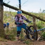 Smiling mountain biker on trail in Dunoon